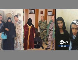 ISIS operatives captured while attempting to flee Mosul, dressed in women's clothes (Al-Aan Channel, July 23, 2017)
