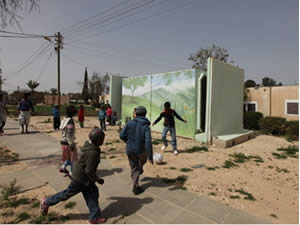 Children run to take cover in a shelter as the sirens sound in Beersheba