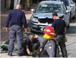 Firefighters and police examine the rocket which hit Beersheba