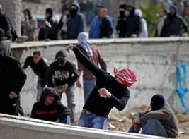 Palestinians throw stones at Israeli security forces in Al-Ram