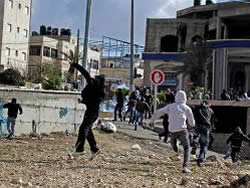 Palestinians throwing stones at Israeli security forces in Al-Ram