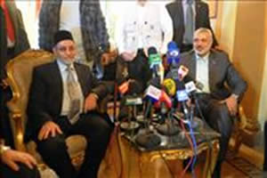 Ismail Haniya, head of the de-facto Hamas administration in the Gaza Strip, meets with Mohammed Badie, general guide of the Muslim Brotherhood in Egypt