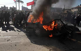 The Batash vehicle after the attack (Wafa News Agency, December 8, 2011)