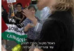 A demonstration in front of a Tesco store with the participation of PSC activists