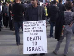 Sign carried in the Trafalgar Square rally (From Richard Millet's blog)