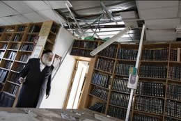 A rocket hits a synagogue in Ashdod (Photo: Amir Cohen for Reuters,, August 19, 2011).