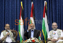 Ismail Haniya, head of the de facto Hamas administration, with the two activists of the Miles of Smiles 4 convoy