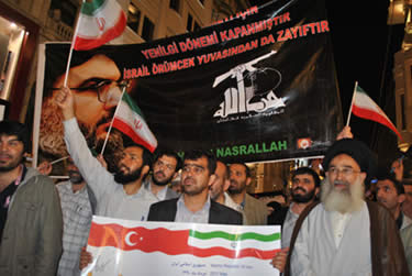 A poster carried by the Iranian delegation at a mass procession to Taksim Square in downtown Istanbul