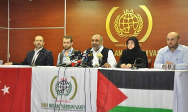 Bülent Yildirim (center) holds a press conference at the IHH headquarters in an Istanbul suburb