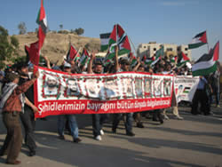 The Turkish delegation to the Nakba Day events in Jordan leads a Palestinian-Jordanian march to the Allenby Bridge