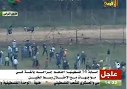Demonstrators throw stones at IDF soldiers on the other side of the border