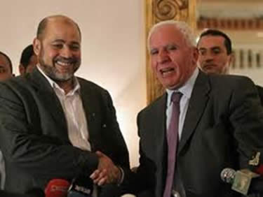 Musa Abu Marzuq, deputy head of the Hamas political bureau and Fatah's Azzam al-Ahmad after the initialing of the Palestinian reconciliation agreement