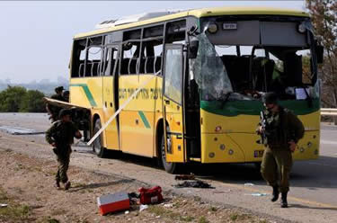 The school bus hit by the anti-tank missile launched by Hamas from the Gaza Strip (Photo by Shalom Gaziel for Reuters, April 7, 2011).