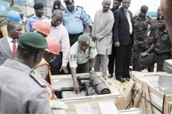 Nigerian security forces display 120mm mortars found aboard the M/V Everest (July, 2010).