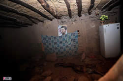 House survives earthquake thanks to Ahmadinejad's photograph