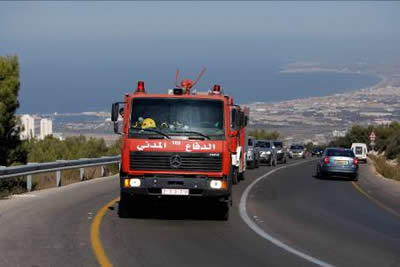 Palestinian Authority fire truck on its way to Mt. Carmel