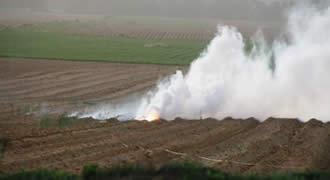 Smoke caused by a 120-mm mortar shell