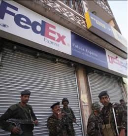 Yemeni policemen guarding the FedEx offices in Sana'a