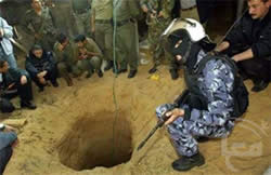 Egyptian security personnel near a tunnel opening