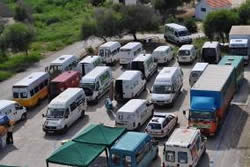 The convoy vehicles wait in Latakia