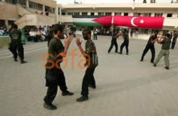 Hand to hand combat under the Palestinian and Turkish flags.