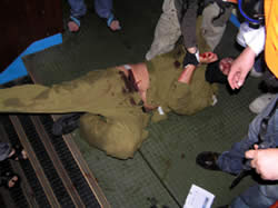 Operatives surrounding an injured IDF soldier whom they had captured.