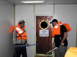 Operatives armed with improvised clubs made from the railings of the ship waiting inside the Mavi Marmara