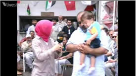 IHH head Bülent Yildirim aboard the Mavi Marmara, holding a small child