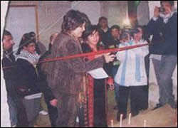 Palestinian Authority minister of welfare Ms. Majida al-Masri cuts the ribbon