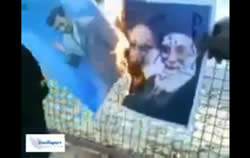 Image from the video showing Khomeini's picture being burned