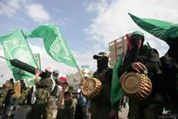 Hamas operatives hold IEDs and Qassam rockets.