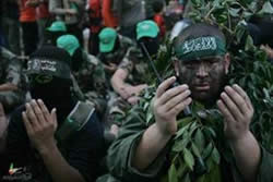 Izz al-Din al-Qassam Brigades operatives pray during the event.