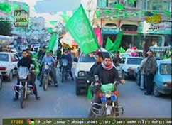Passengers way Hamas flags in vehicles on their way to the main rally in Gaza City