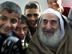 Sheikh Yassin with smiling Palestinian children