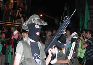 Masked and armed teenagers at a Hamas protest rally in Gaza