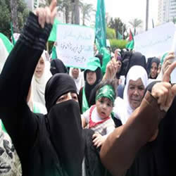 women carrying babies with Hamas emblems