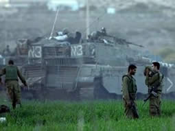 IDF soldiers resting on the outskirts of the Gaza Strip