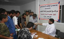 Al-Falah Charitable Society distributing funds in Gaza City