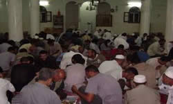 Breaking the Ramadan fast, a mass feast in one of the Gaza Strip mosques.