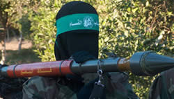 A woman Hamas operative carrying an RPG launcher