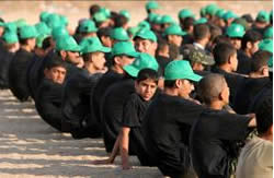 Boys at a Hamas summer camp in the Gaza Strip wearing green Hamas hats.