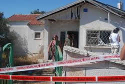 A house directly hit by rocket fire