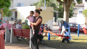 Mothers and children playing in the park