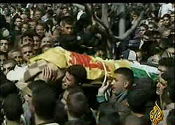 Shehadeh's body is wrapped in the Hezbollah flag