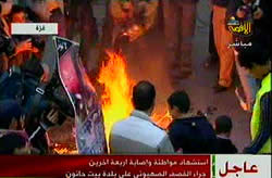 Bush's picture burned during the demonstration