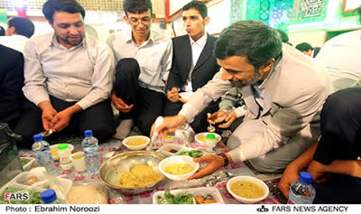 the president of Iran breaks the Ramadan fast with orphans