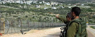 IDF soldiers conduct anti-terrorism activities near the security fence in Judea and Samaria (IDFSpokesman, May 15, 2012)