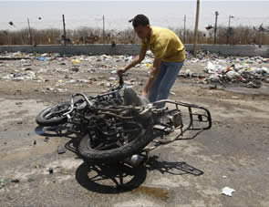 A motorbike damaged by the Israeli Air Force attack in the Gaza Strip (Wafa News Agency, June 18, 2012)