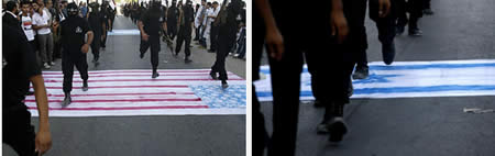 Palestinian terrorist operatives march over the American and Israeli flags (PALDF forum website, July 7, 2012)