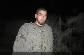 Ismail al-Teli, Izz al-Din al-Qassam Brigades terrorist operative, wears a camouflage uniform. He was killed in an IDF aerial strike in the northern Gaza Strip (Filastin al-'Aan, October 24, 2012).
